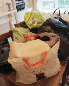 Deckuttering the house, becoming minimalist, less is more, family minimalism bags of clutter